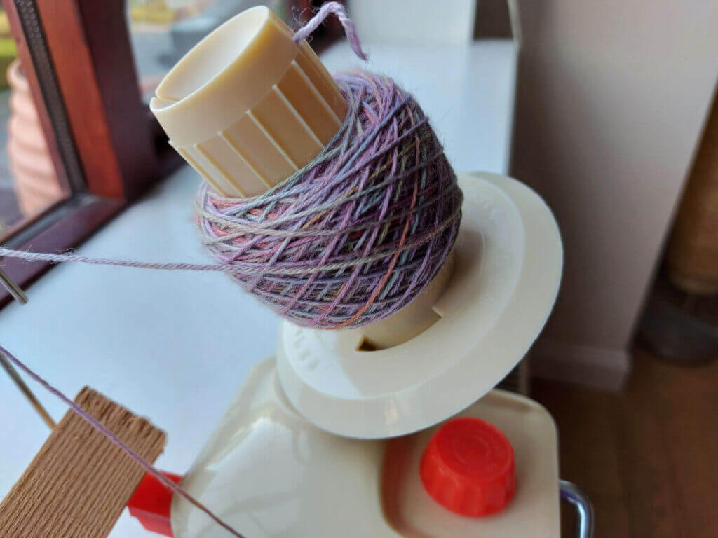 A small yarn cake on the winder.